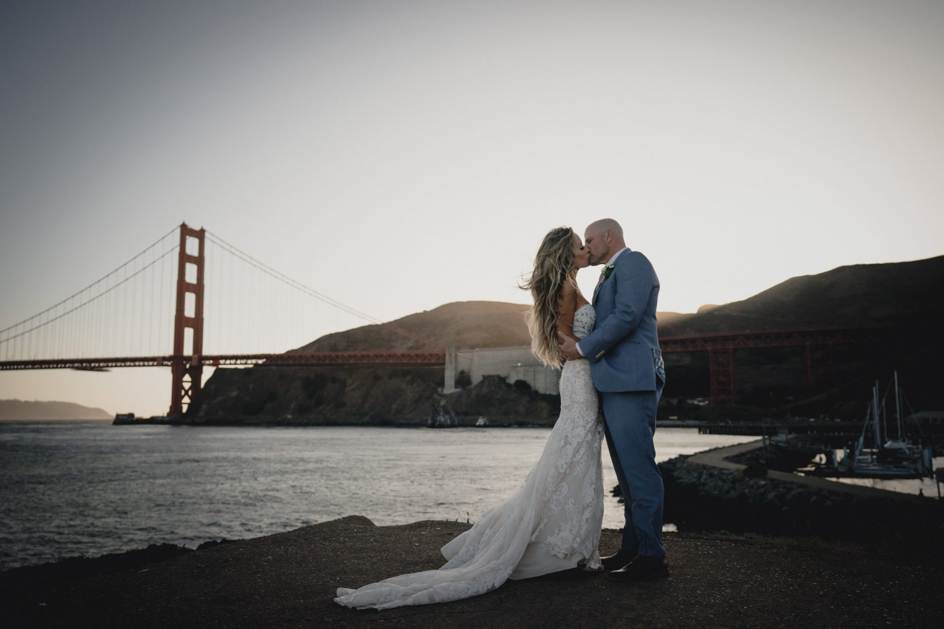 Couple kissing near Golden Gate Bridge at Cavallo Point