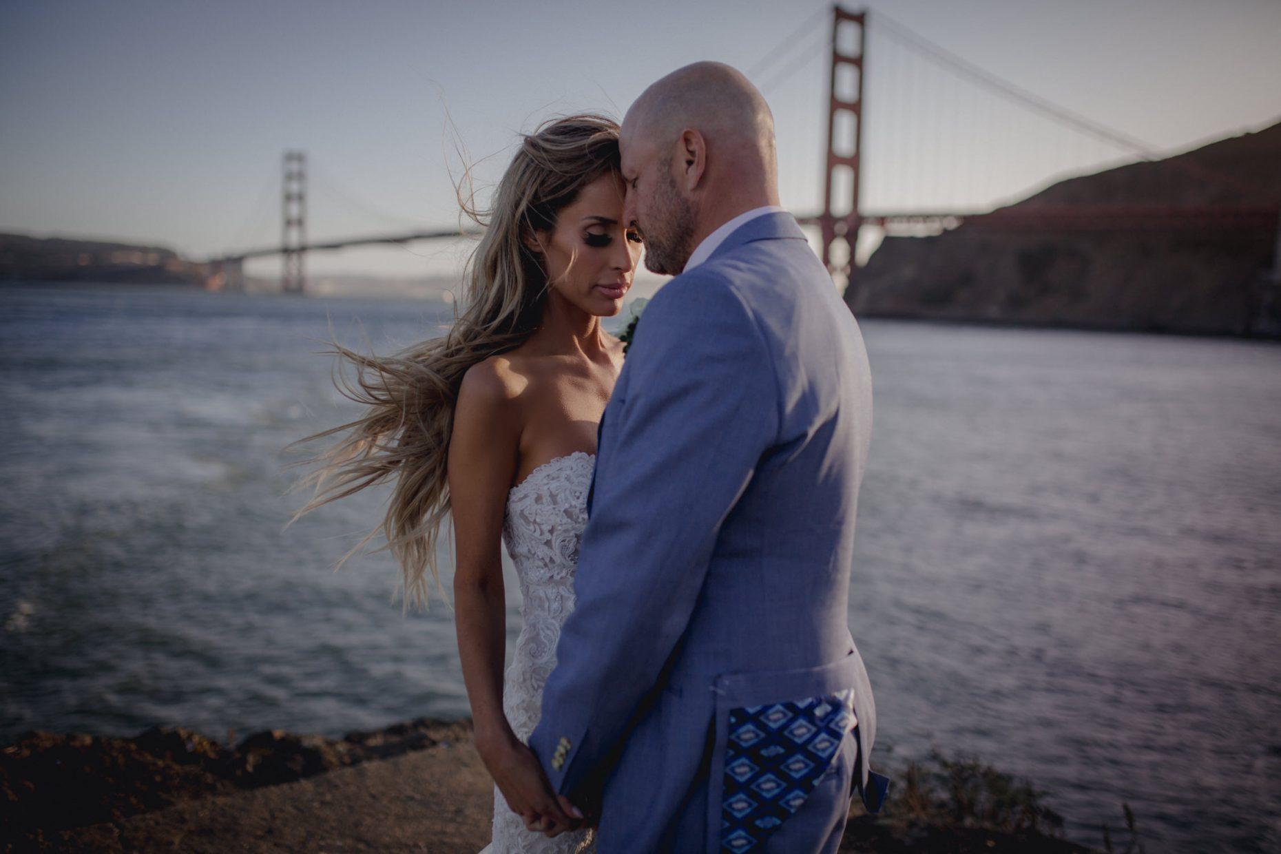 Couple embraced near Golden Gate Bridge